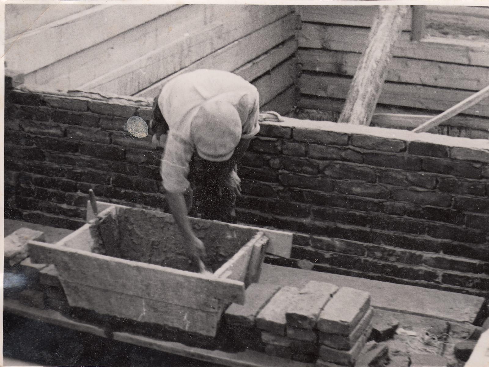 A members of a Jewish labor battalion lays bricks in Hajduhadhaz.