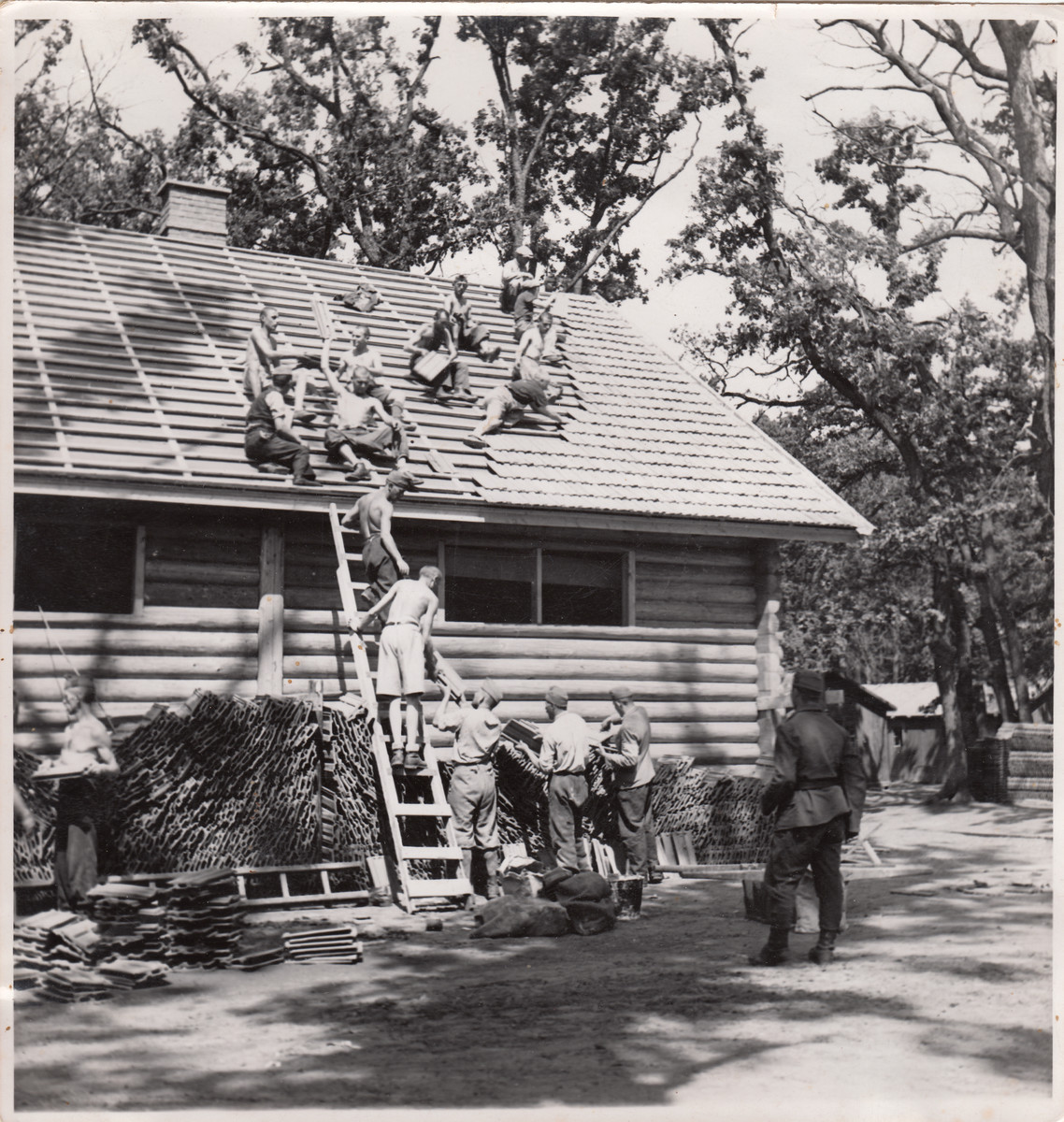 Members of a Jewish labor battalion construct the roof to a building in Hajduhadhaz.