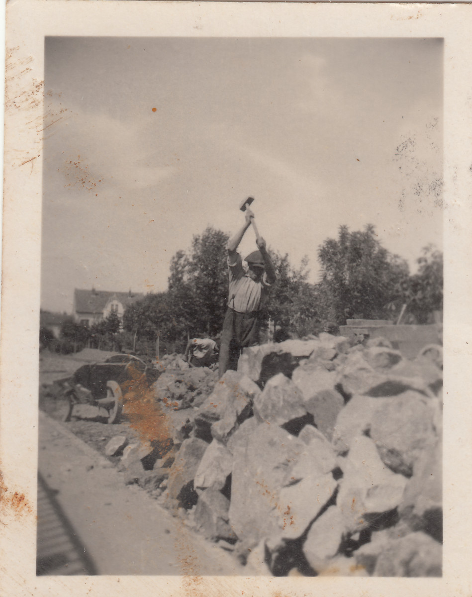 Members of a Jewish labor battalion smash rocks at a construction site in Hajduhadhaz.