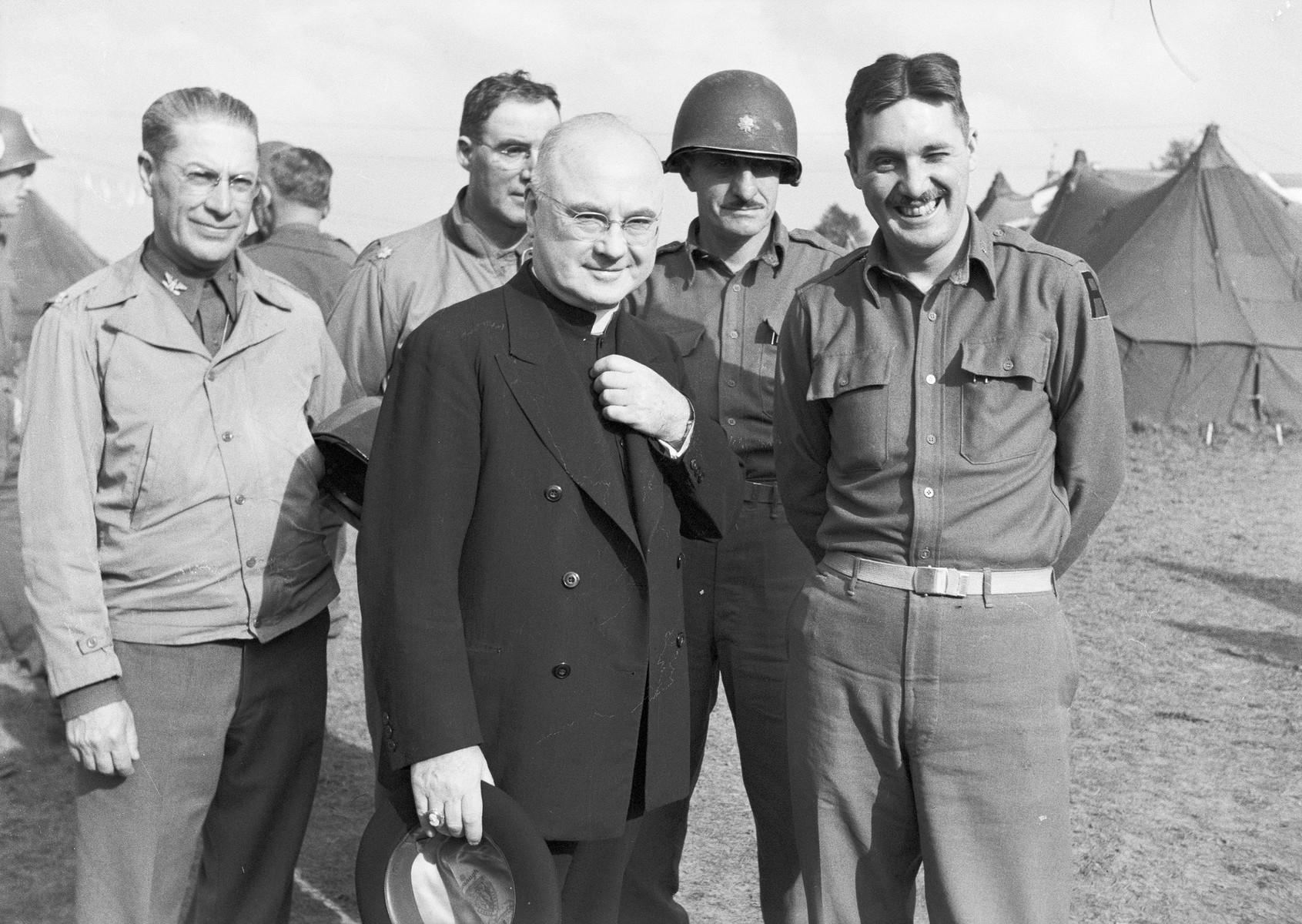 Archbishop Francis J. Spellman poses with American servicemen after the Invasion of Normandy.    Spellman, as military vicar of the United States armed forces, traveled extensively throughout WWII.  During this time he met with military leaders and heads of state, bas well as American servicemen fighting in all theaters of the war.