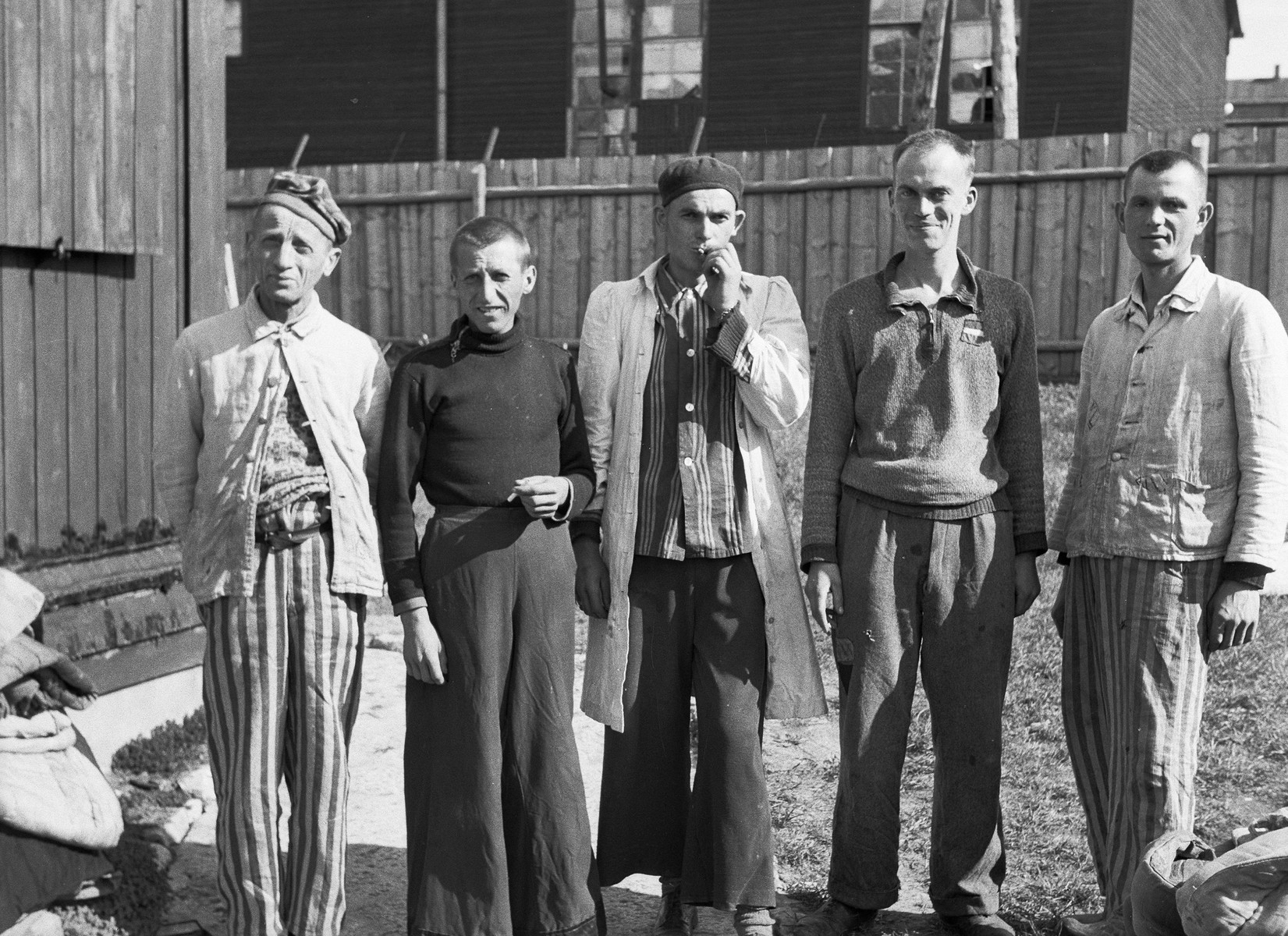 Survivors at Buchenwald pose for a photograph taken by a U.S. Army medical officer with the 45th Evacuation Hospital.    The 45th Evacuation Hospital arrived at Buchenwald after liberation of the camp and was tasked with providing a range of care to newly liberated inmates. Their duties were soon directed to the treatment and evacuation of inmates suffering from tuberculosis.  With the assistance of several prisoners who had been camp physicians, the 45th managed to prevent further spread of the disease and to vastly improve the quality of treatment that individuals received.