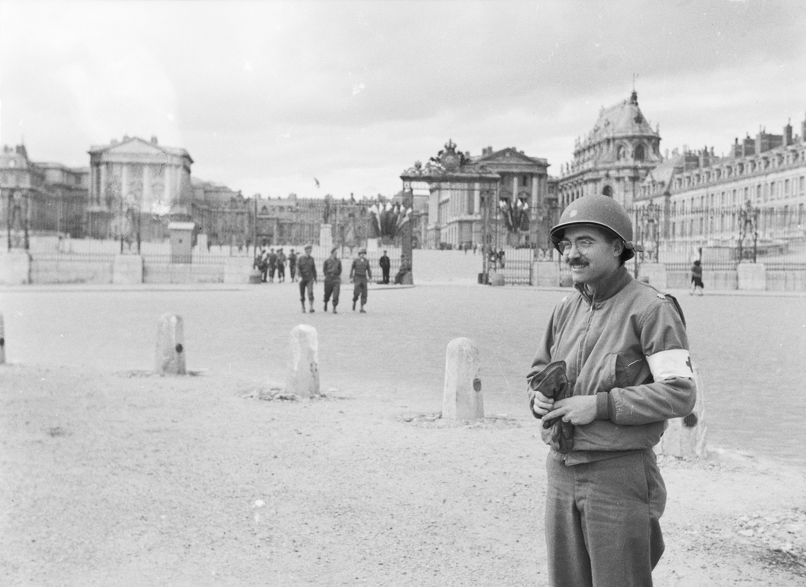 Dr. William G. Birch stands in a city square in Germany.