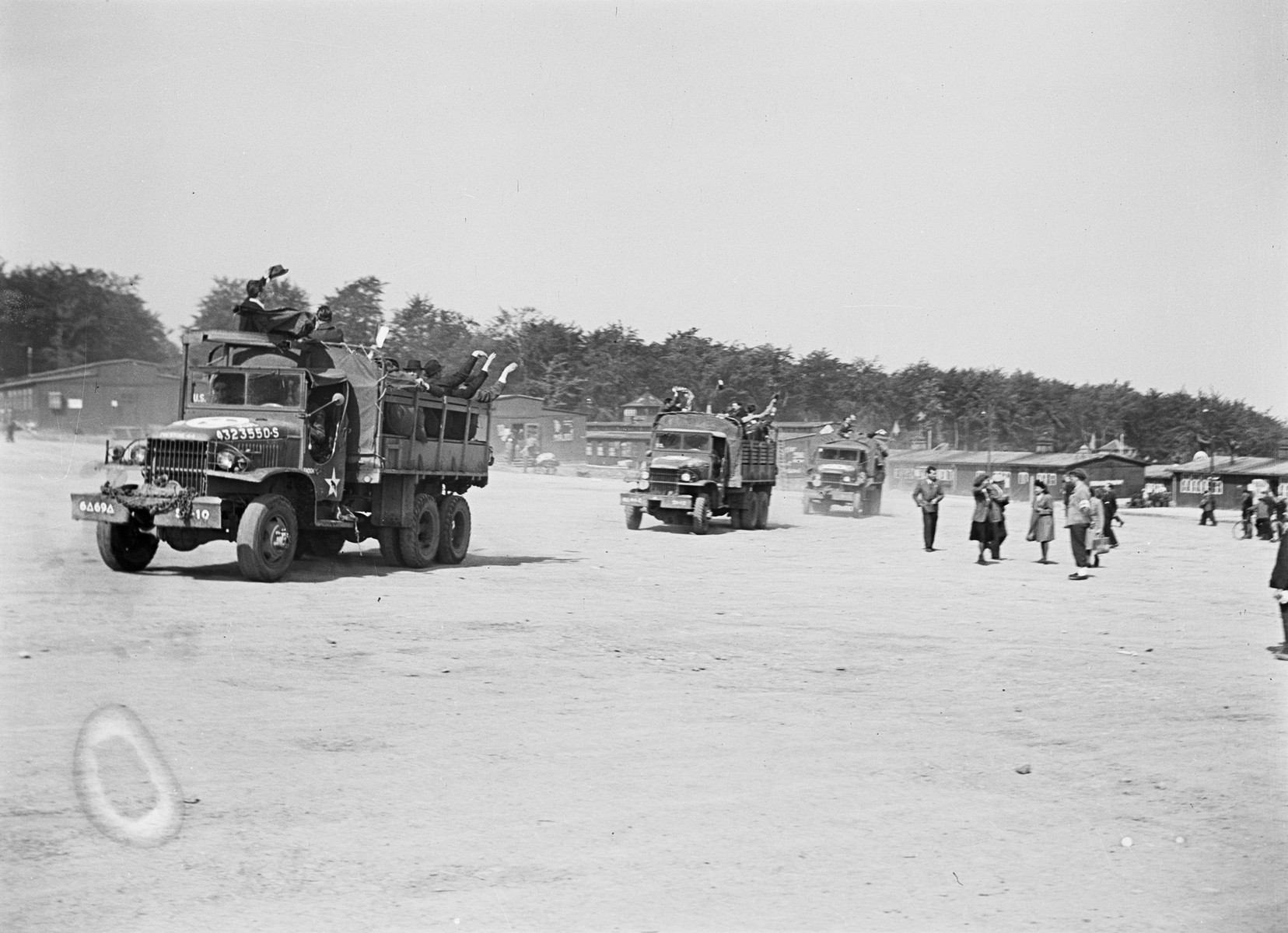 U.S. Army trucks carrying former Czech concentration camp inmates depart Buchenwald for repatriation.