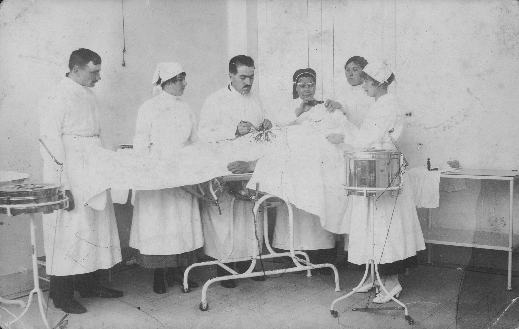 Maniefa Willenberg (pictured second from left) assists during a surgical operation.