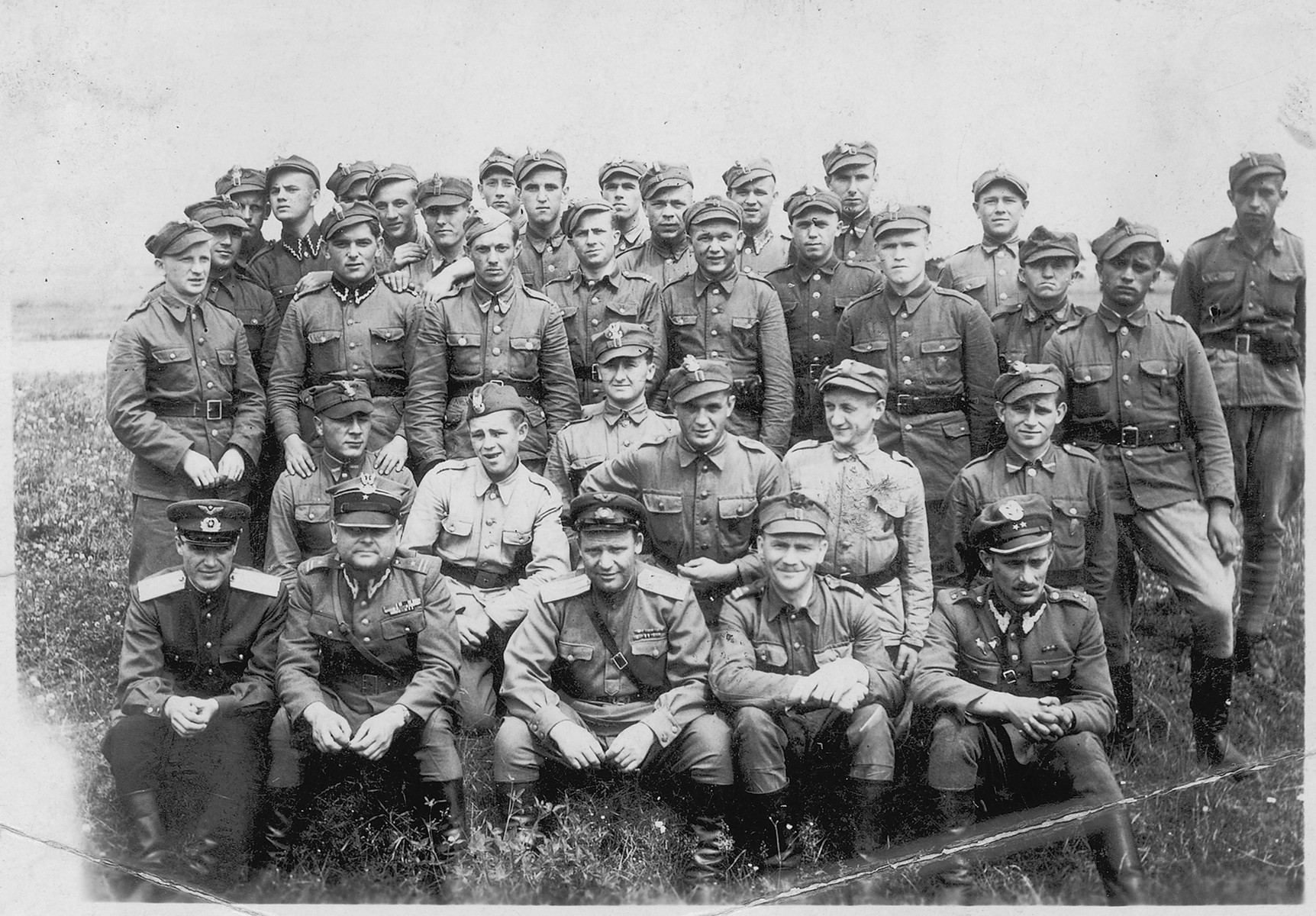 Group portrait of soldiers in the postwar Polish army.  Shmuel Willenberg is pictured in the front row on the far right.