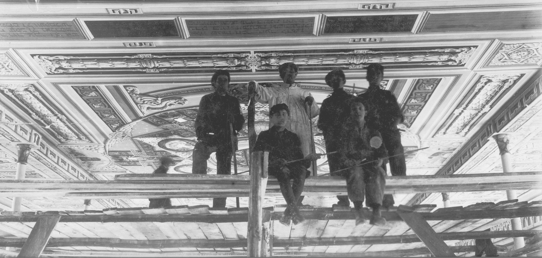 Perec Willenberg (pictured center, wearing white) and his staff paint the old synagogue ceiling mural in Czestochowa.