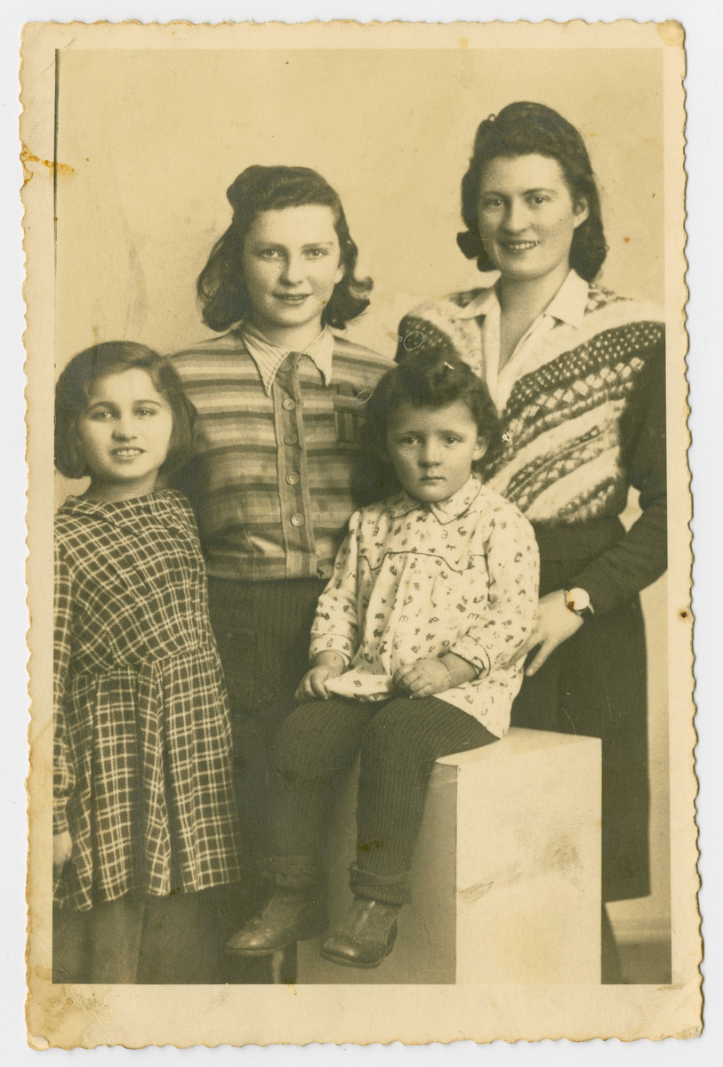 Bronia Bruenner poses with her aunt and cousins after liberation.  From left to right are Bronia, Rutka Bruenner, Masha Berger and Rosa Berger. Rutka Bruenner also escaped German-occupied Poland for Slovakia with the Kalb rescue mission.