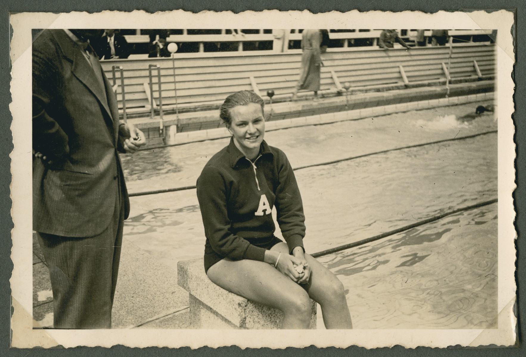 Argentinian swimmer Jeannette Morven Campbell sits by the side of the pool.