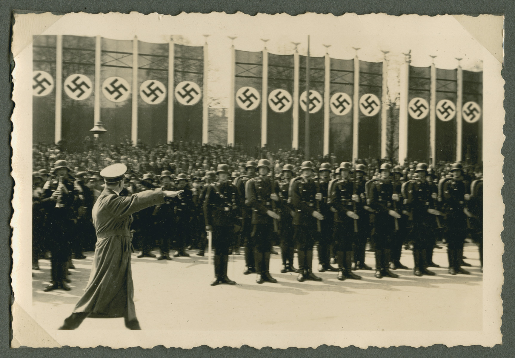 Adolf Hitler walks past his honor guard at a large gathering in the Lustgarten in Berlin.