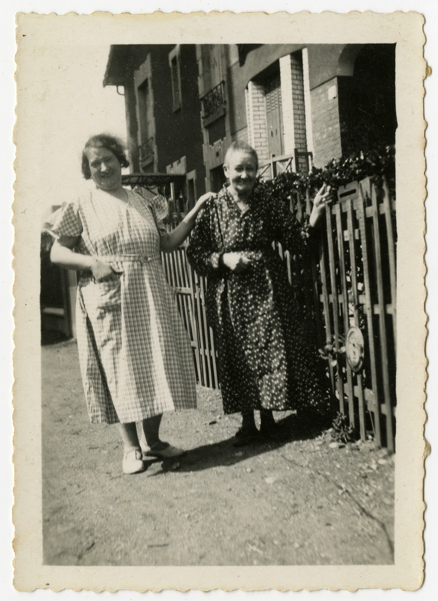 Two women stand outside a house [probably relatives of Izak Weber in Skole, Poland.]