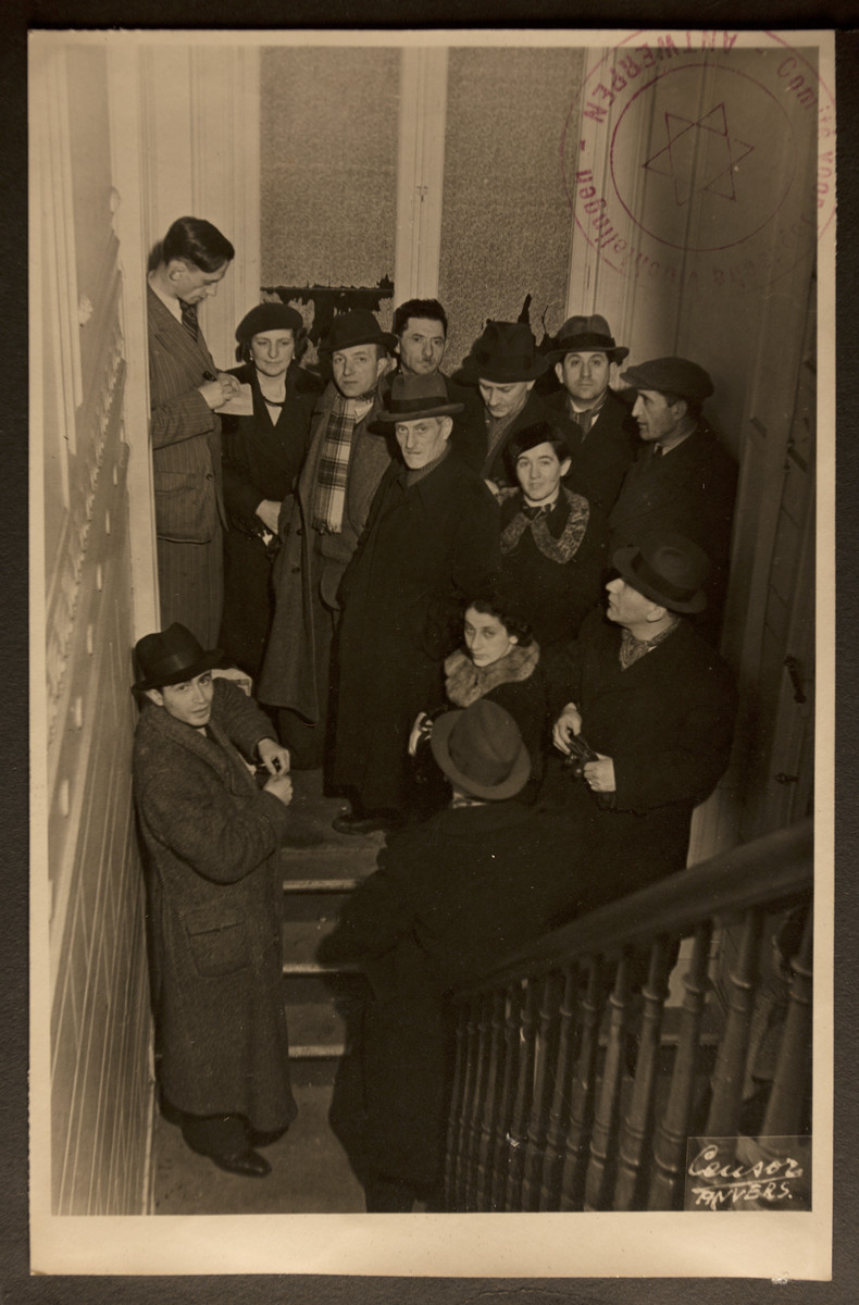 German Jewish refugees gather on the stairwell of the Jewish Refugee Aid Committee of Antwerp.