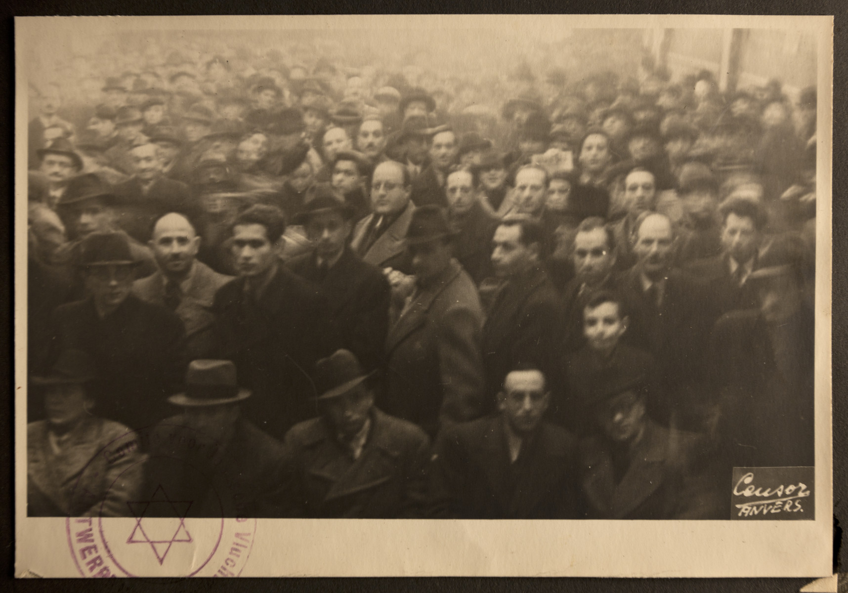 German Jewish refugees crowd outside the offices of the Jewish Refugee Aid Committee of Antwerp.