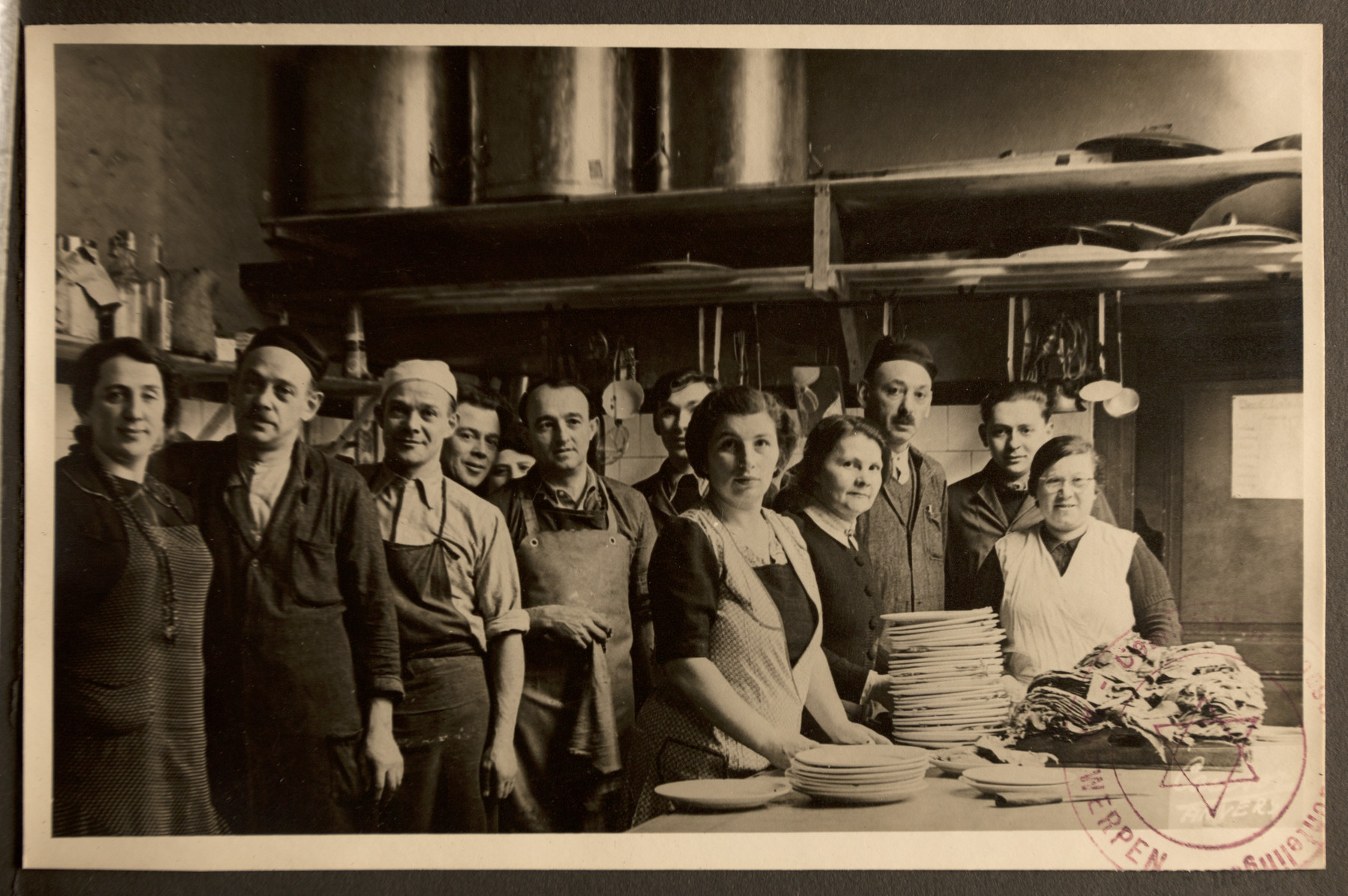 Group portrait of the kitchen staff for the Jewish Refugee Aid Committee of Antwerp.