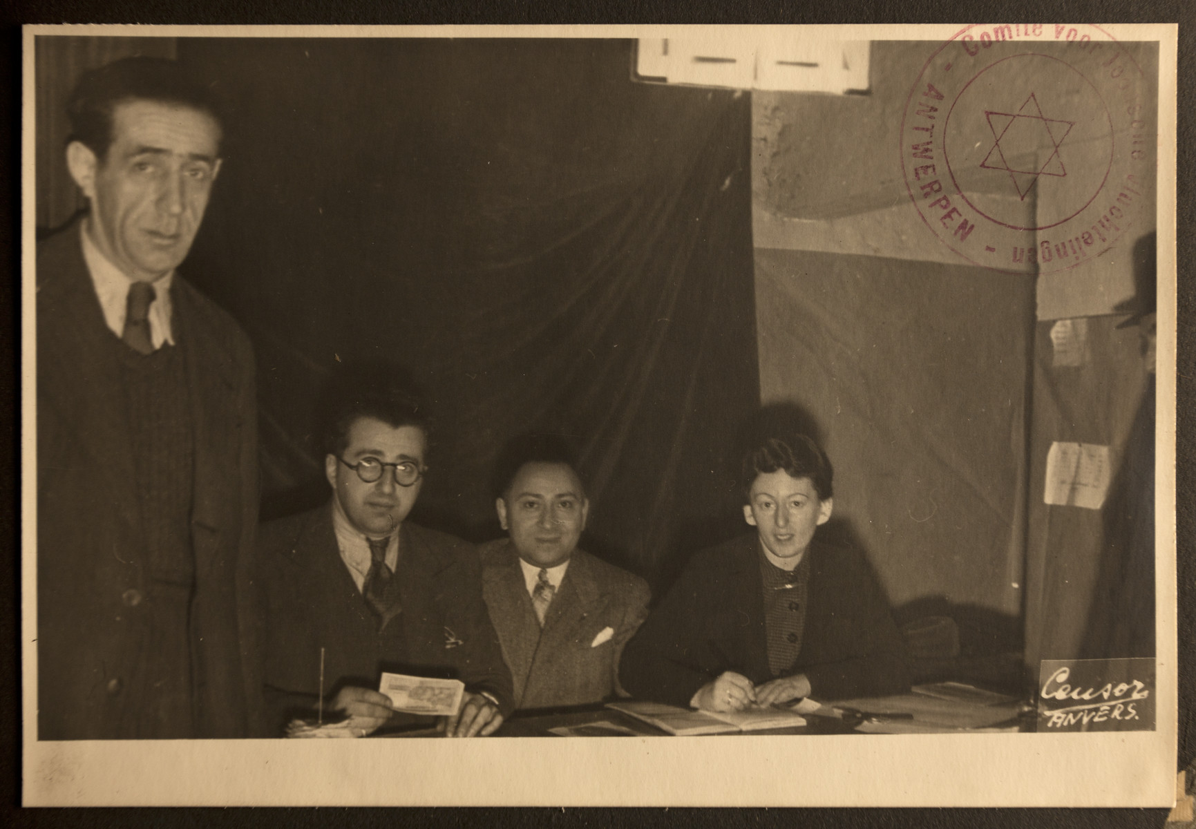Group portrait of members of the Jewish Refugee Aid Committee of Antwerp.  Leopold Guttman is seated second from the left.