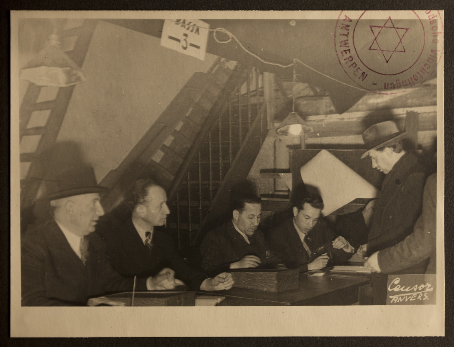 The Jewish Refugee Aid Committee of Antwerp processes paperwork for a new refugee from Germany.