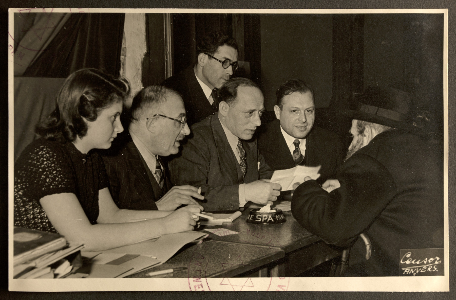 The Jewish Refugee Aid Committee of Antwerp processes information for a new refugee from Germany.