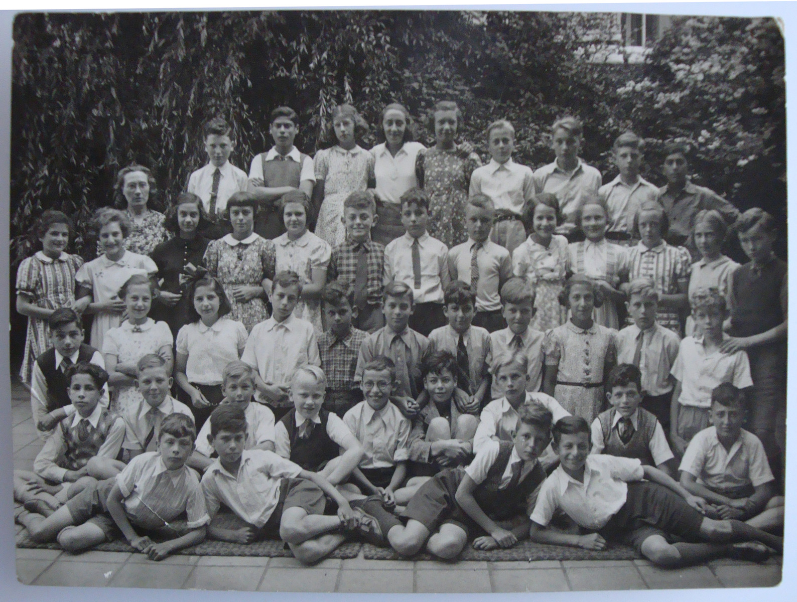 Group portrait of elementary school students in Amsterdam.    Among those pictured are Eva Geiringer (right) and Suzanne Lederman (on the far left).