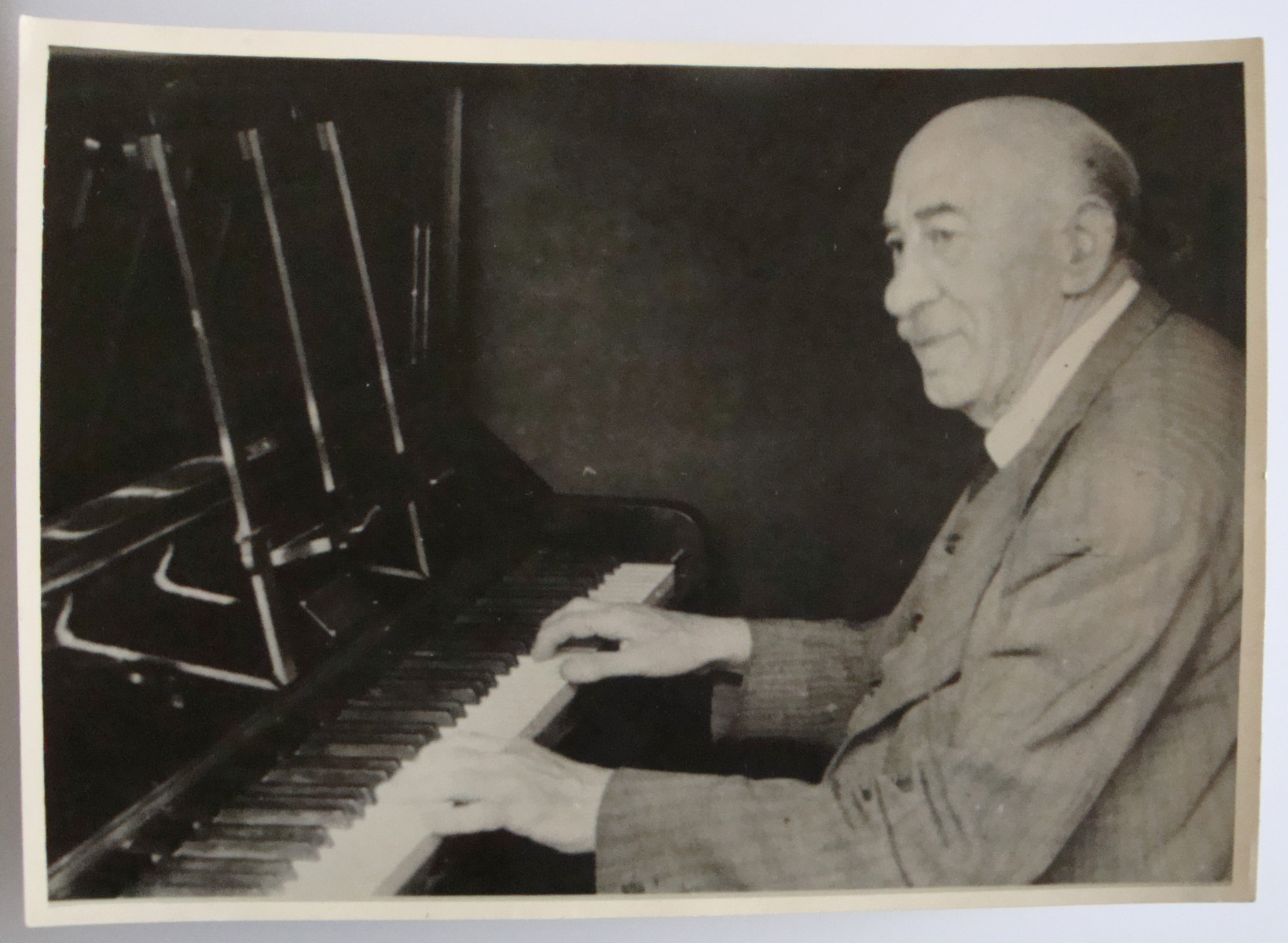 Rudolf Markovitz, an Austrian Jewish refugee and grandfather of the donor, plays the piano in an English pub.