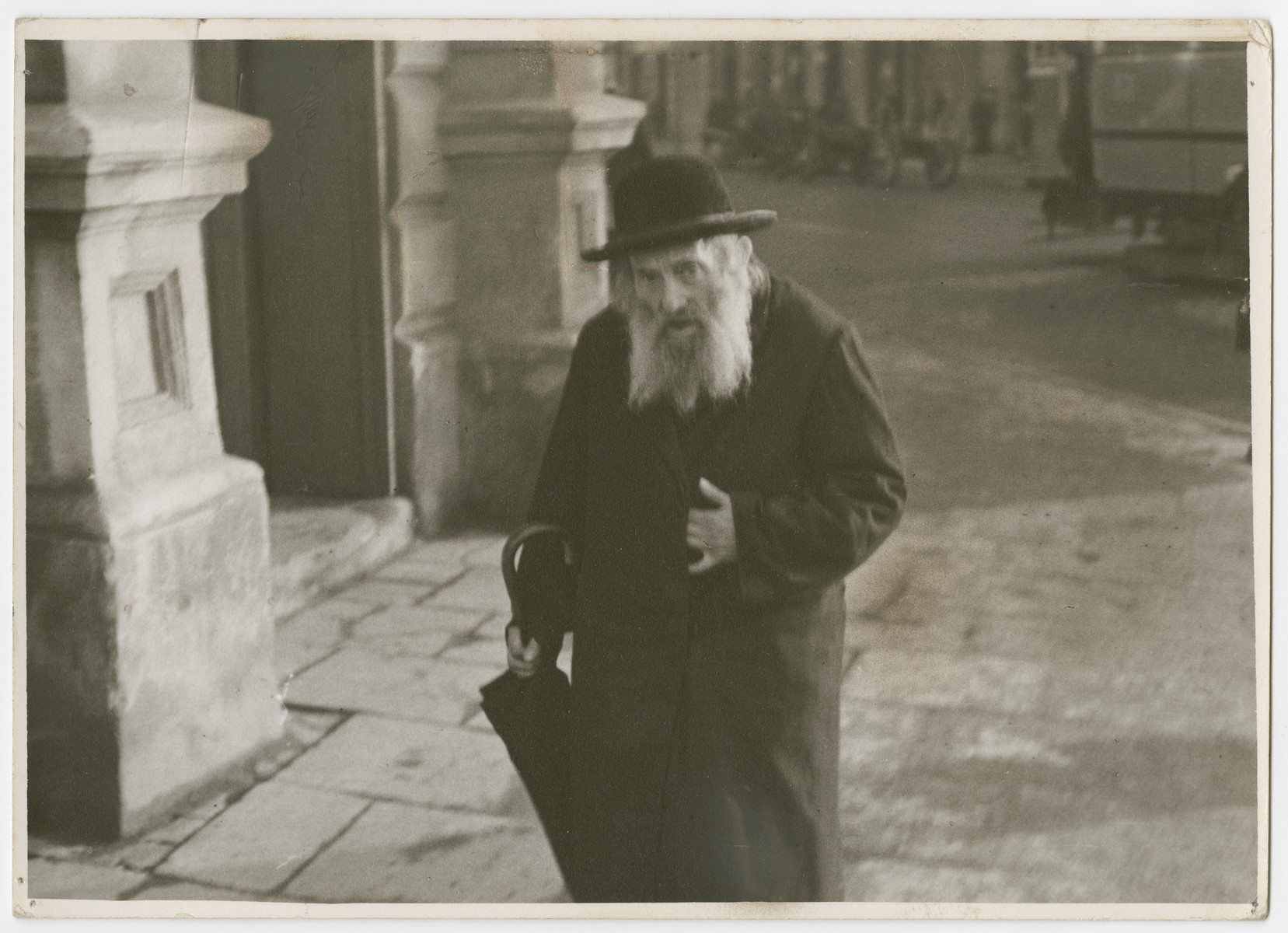 "An elderly Jewish man  walks down Nalewki Street in Warsaw.  Photograph is used on page 108 of Robert Gessner's ""Some of My Best Friends are Jews."""