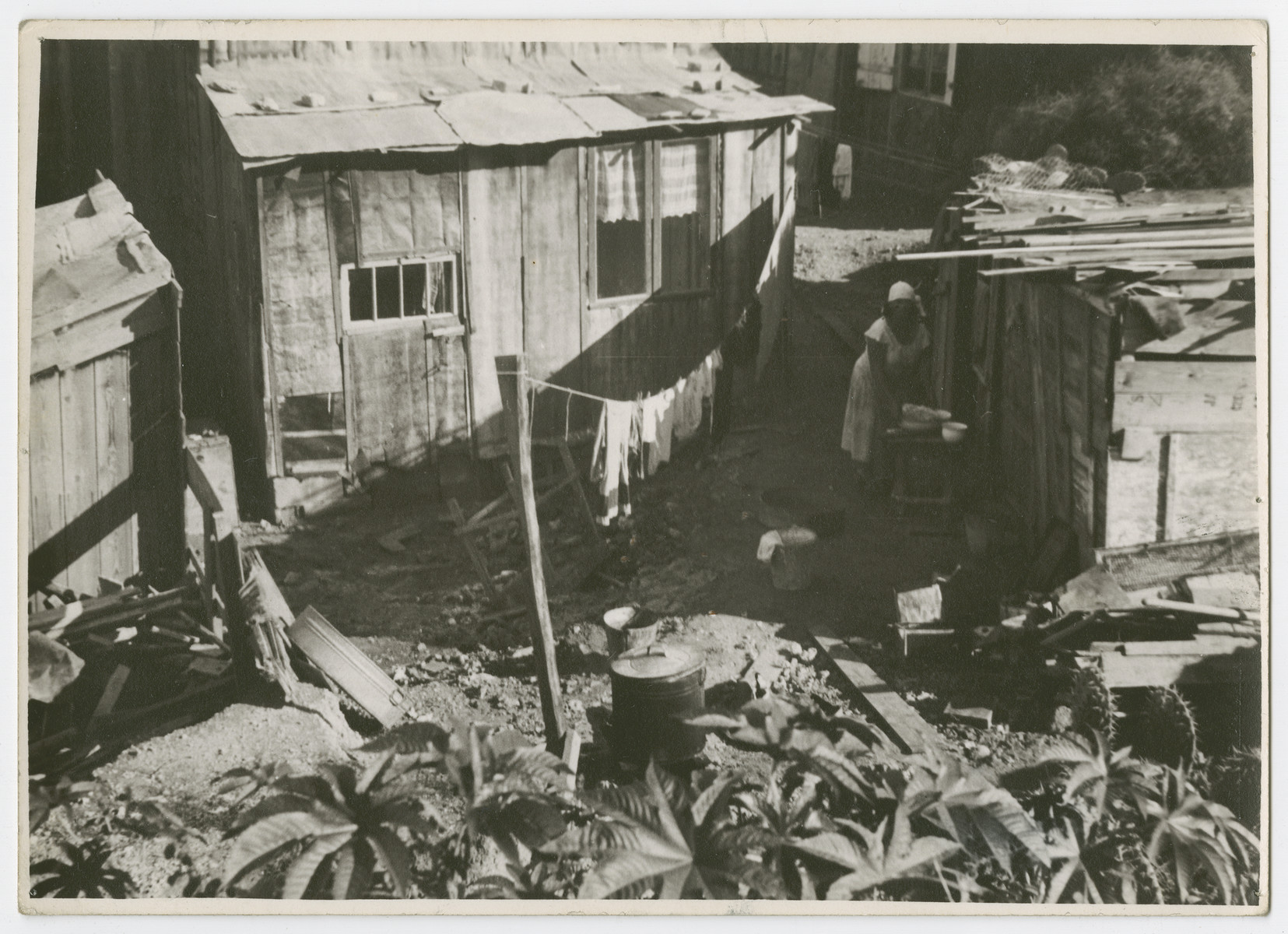"View of a workers' neighborhood ""Shuhunat Haoved"" in Tel Aviv.  Photograph is used on page 174 of Robert Gessner's ""Some of My Best Friends are Jews."" The pencil inscription on the back of the photograph reads, ""Jewish."""