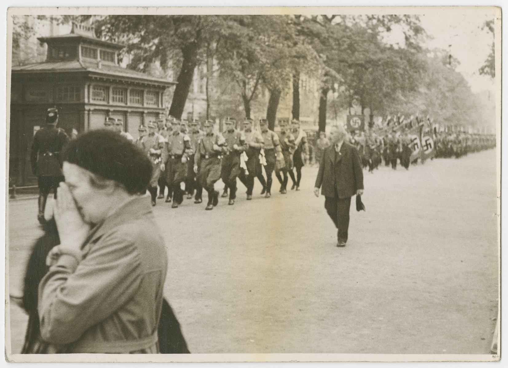 "SA troops march down a street in Germany.  Photograph is used on page 64 of Robert Gessner's ""Some of My Best Friends are Jews.""  The pencil inscription on the back of the photograph reads, ""Germany."""