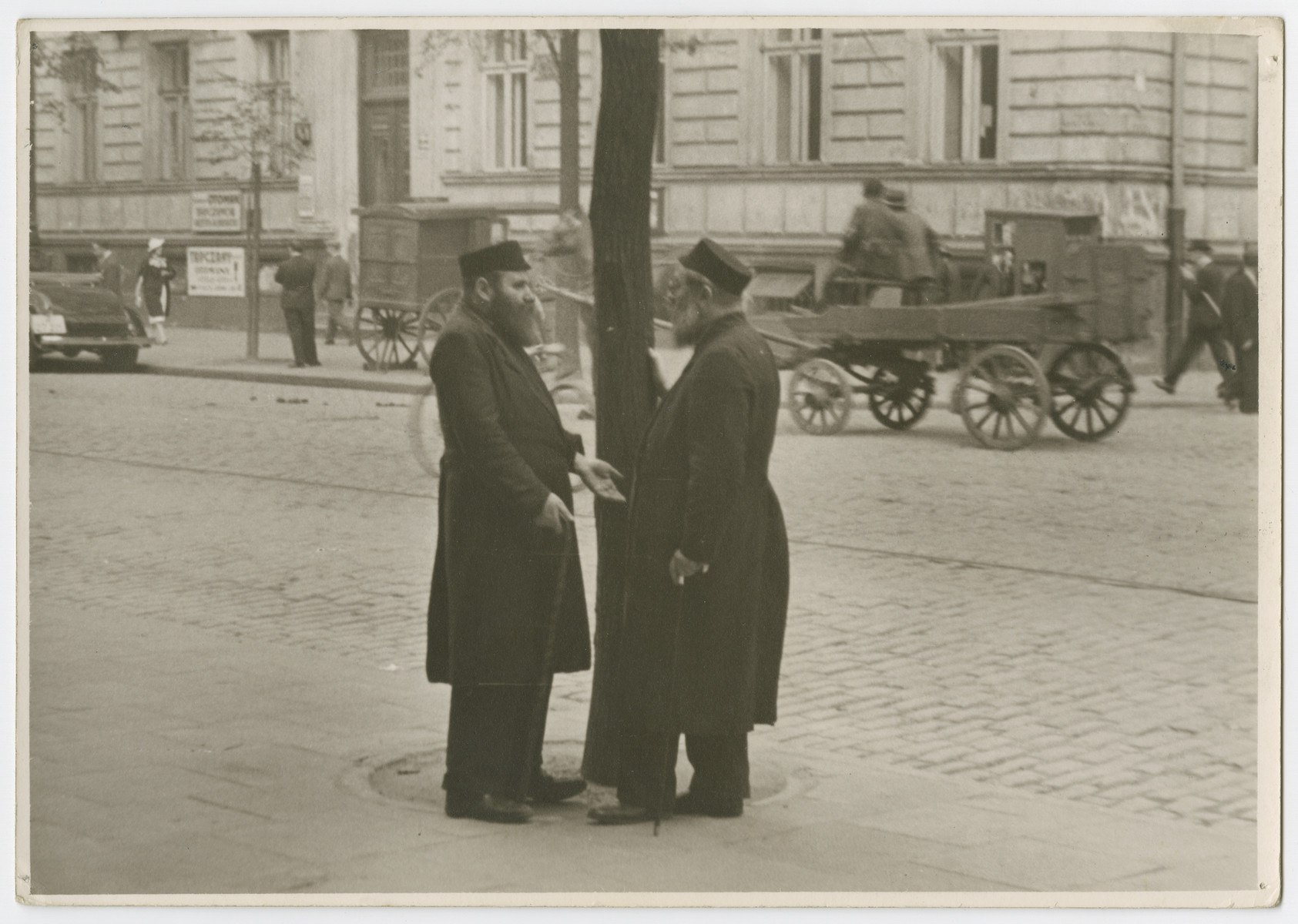 "Two Jewish men converse on a street in Warsaw.  Photograph is used on page 116 of Robert Gessner's ""Some of My Best Friends are Jews."""