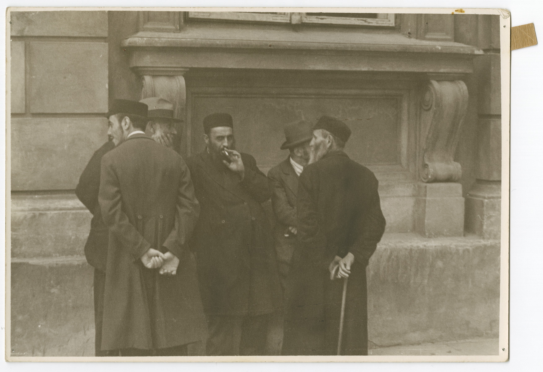 "A group of Jewish men gather outside the stock exchange in Warsaw.  Photograph is used on page 117 of Robert Gessner's ""Some of My Best Friends are Jews."" The pencil inscription on the back of the photograph reads, ""outside of stock exchange."""