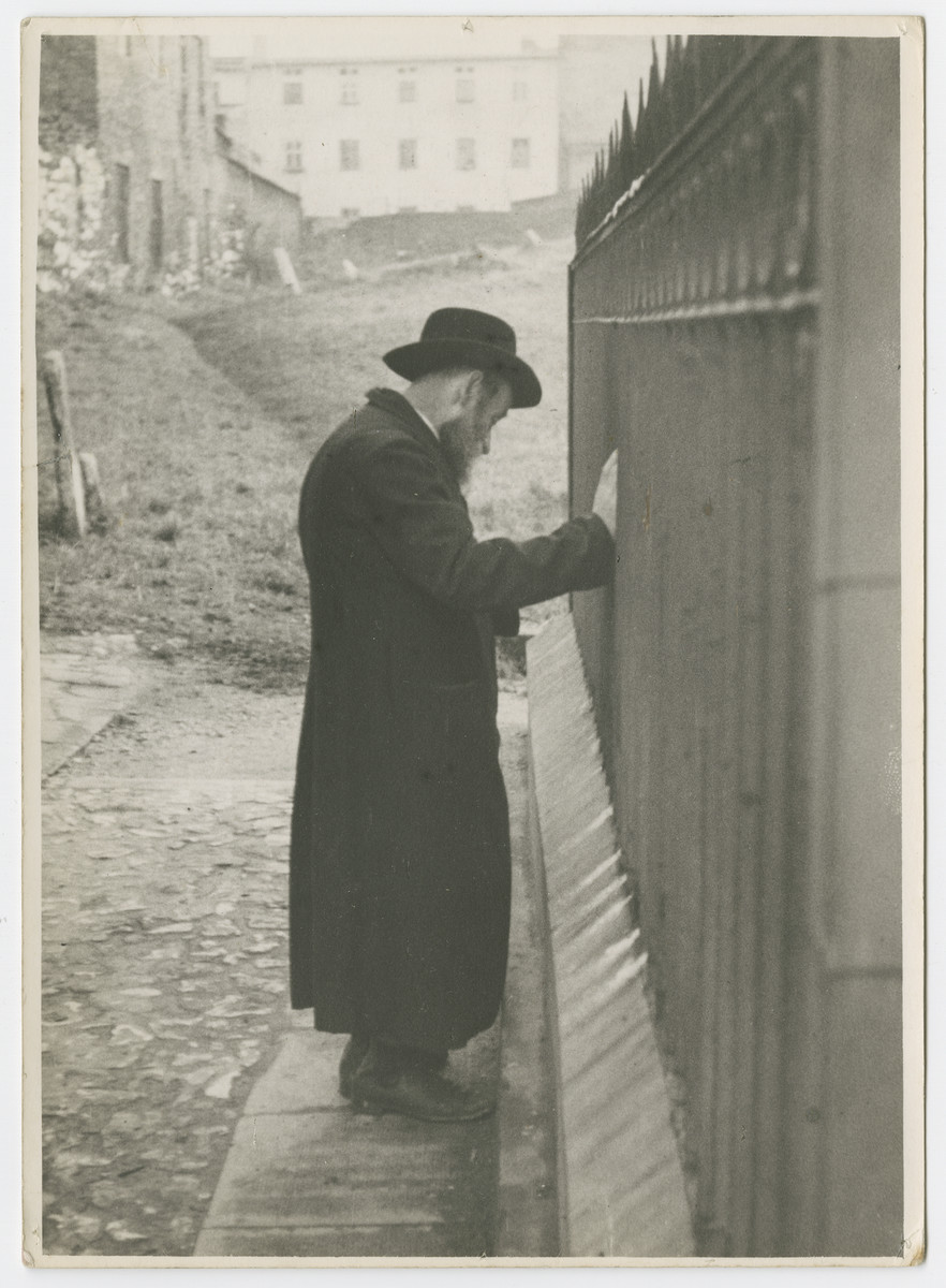 "A religious Jewish man leans against a wall [possibly in prayer.]  Photograph is used on page 146 of Robert Gessner's ""Some of My Best Friends are Jews."""