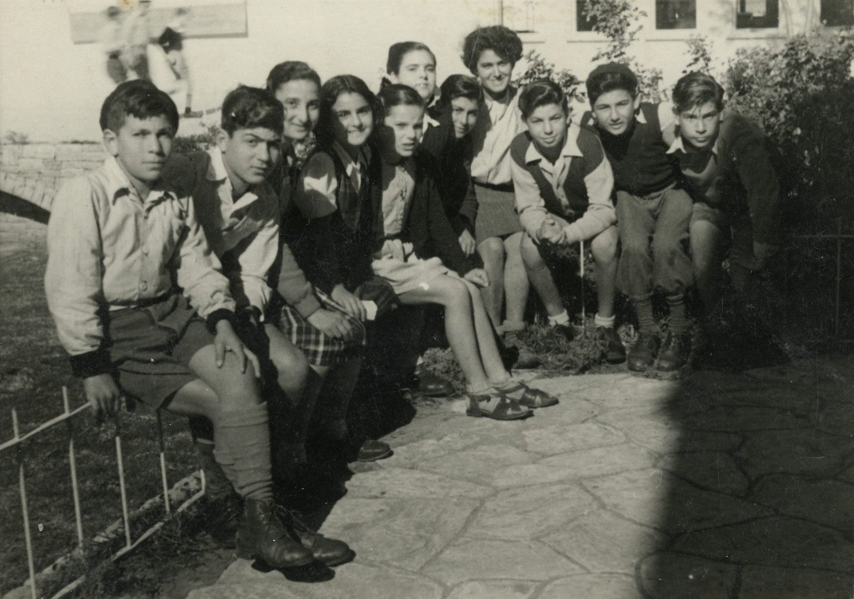 Nadia Cohen (with short hair) poses with the children that she is taking care of in settlement.