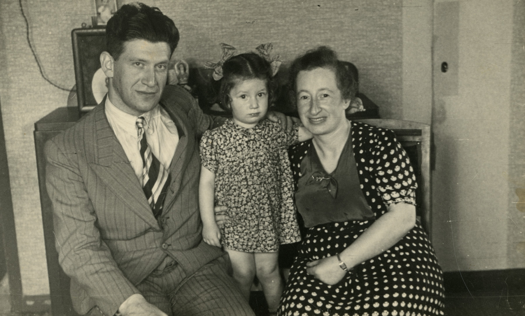 Postwar portrait of the van West family, a Dutch-Jewish family who survived in hiding.  Pictured are Mozes, Rosa and Rachel van West-van den Bergh.