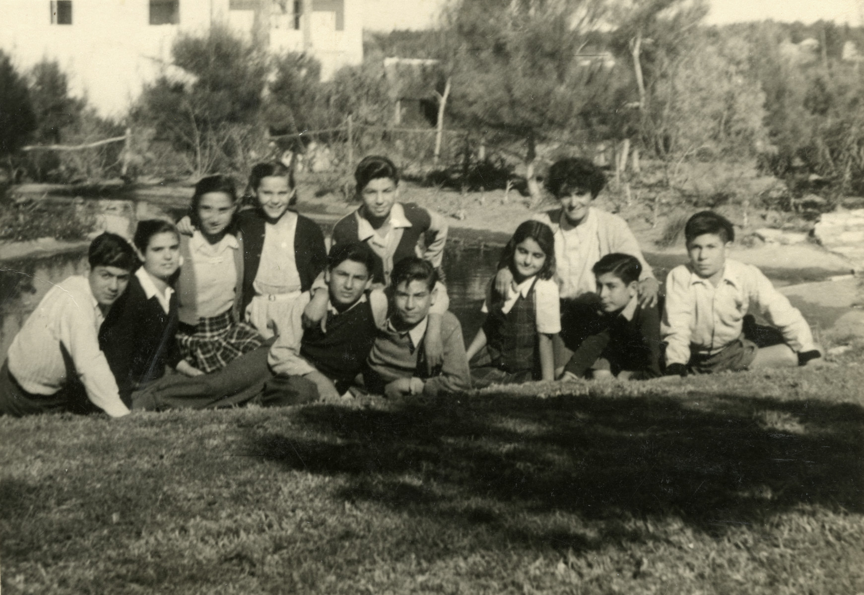 Nadia Cohen poses with a group of children who came on Aliyah.   She is pictured in the back on the right (with short black hair).