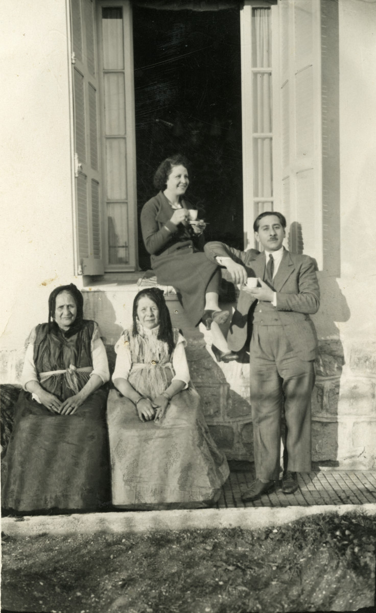 Margalith (Anna Claude) Ghozlan's parents and grandparents are pictured in front of their house. Anna's father built this house before he married.