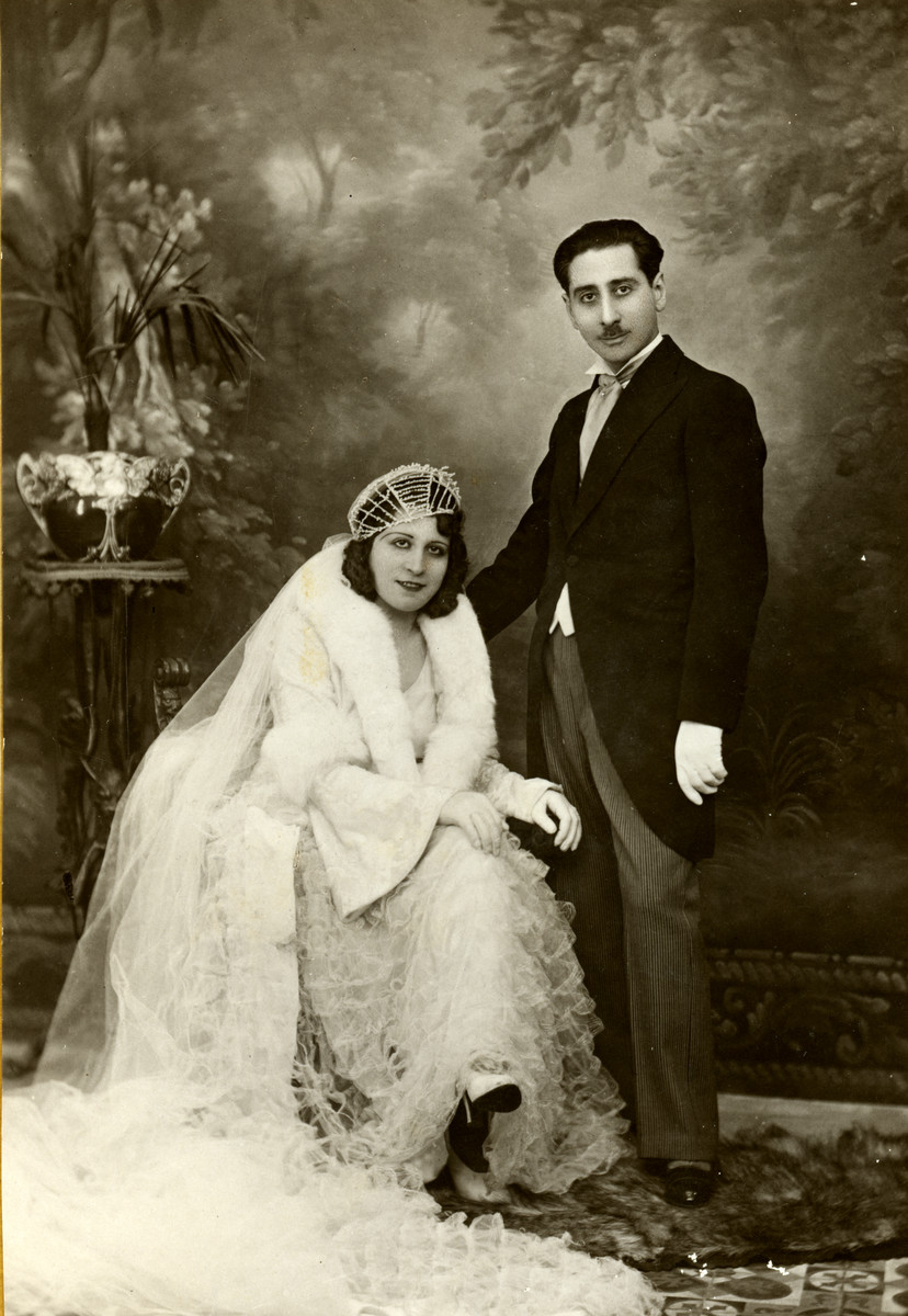 Studio wedding portrait of Reine and Yishua Ghozlan.