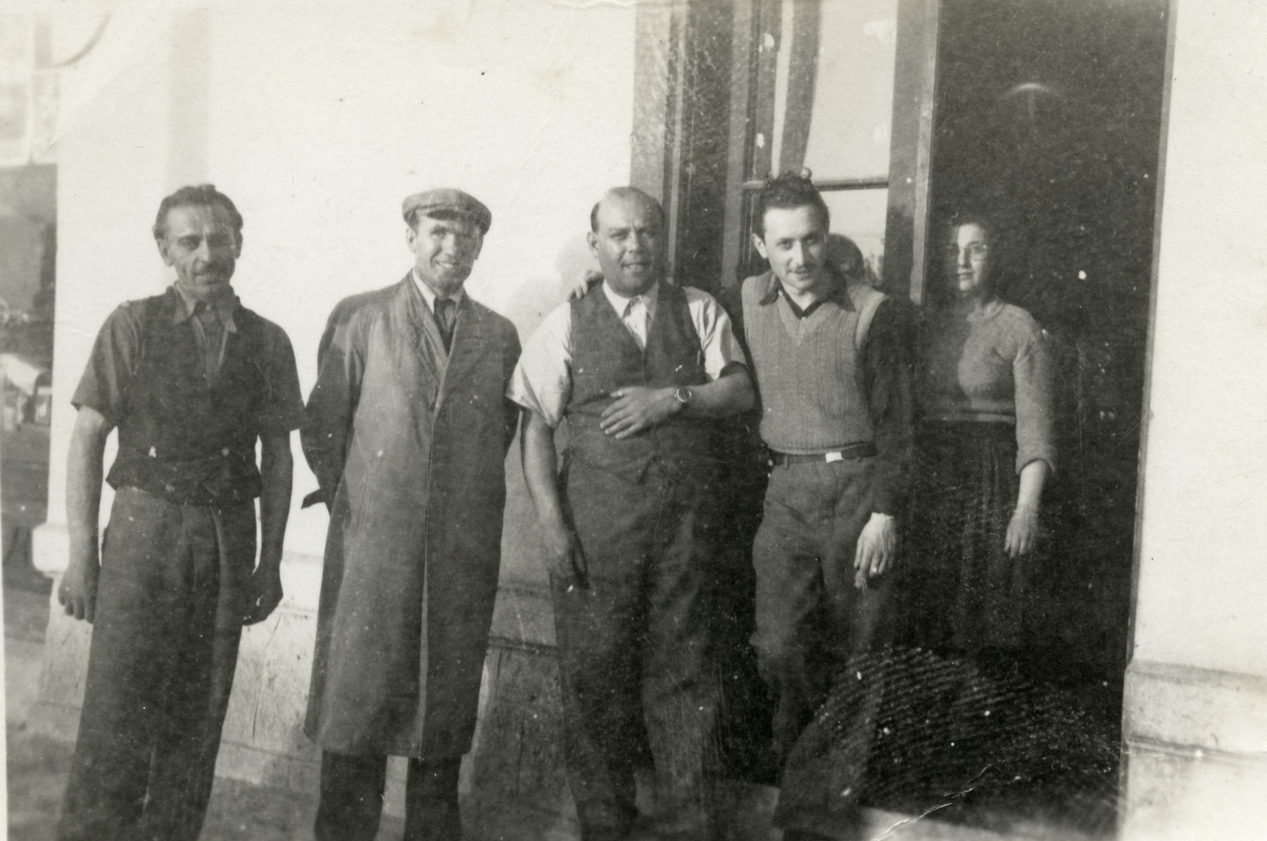 Zoltan Meisels poses with his employees outside his store in Presov; his wife Cecilia is at the back, right.