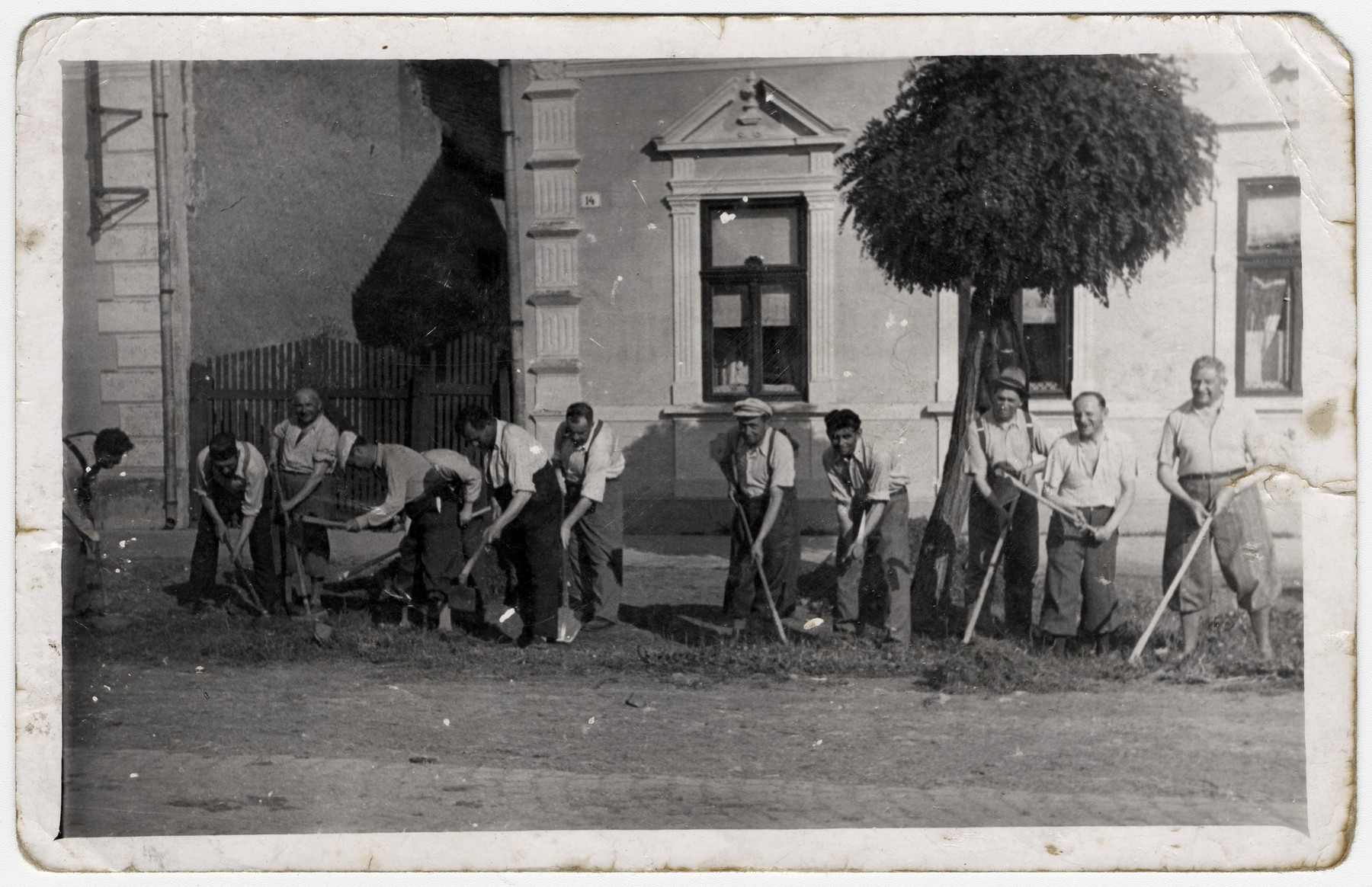 Jewish men perform forced labor digging on the side of a road in Debrecen.  Among those pictured in Mozes Loewinger.