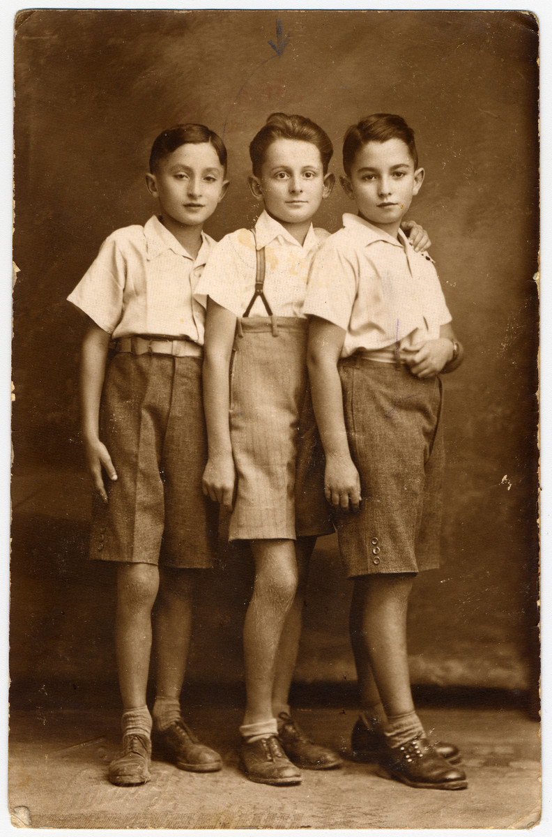 Studio portrait of three Slovak Jewish boys.  Richard Brand, the brother of the donor, is pictured in the center.  He perished in Auschwitz the following year.