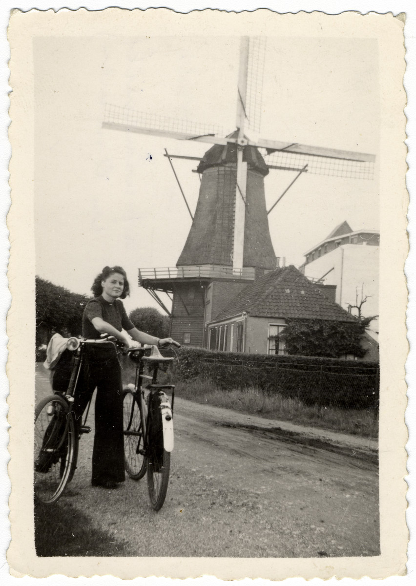 Ina Soep goes for a bicycle ride in the countryside shortly after the German invasion of The Netherlands.  The second bicycle belonged to her boy friend who took the photo and was later killed following a German reprisal raid.