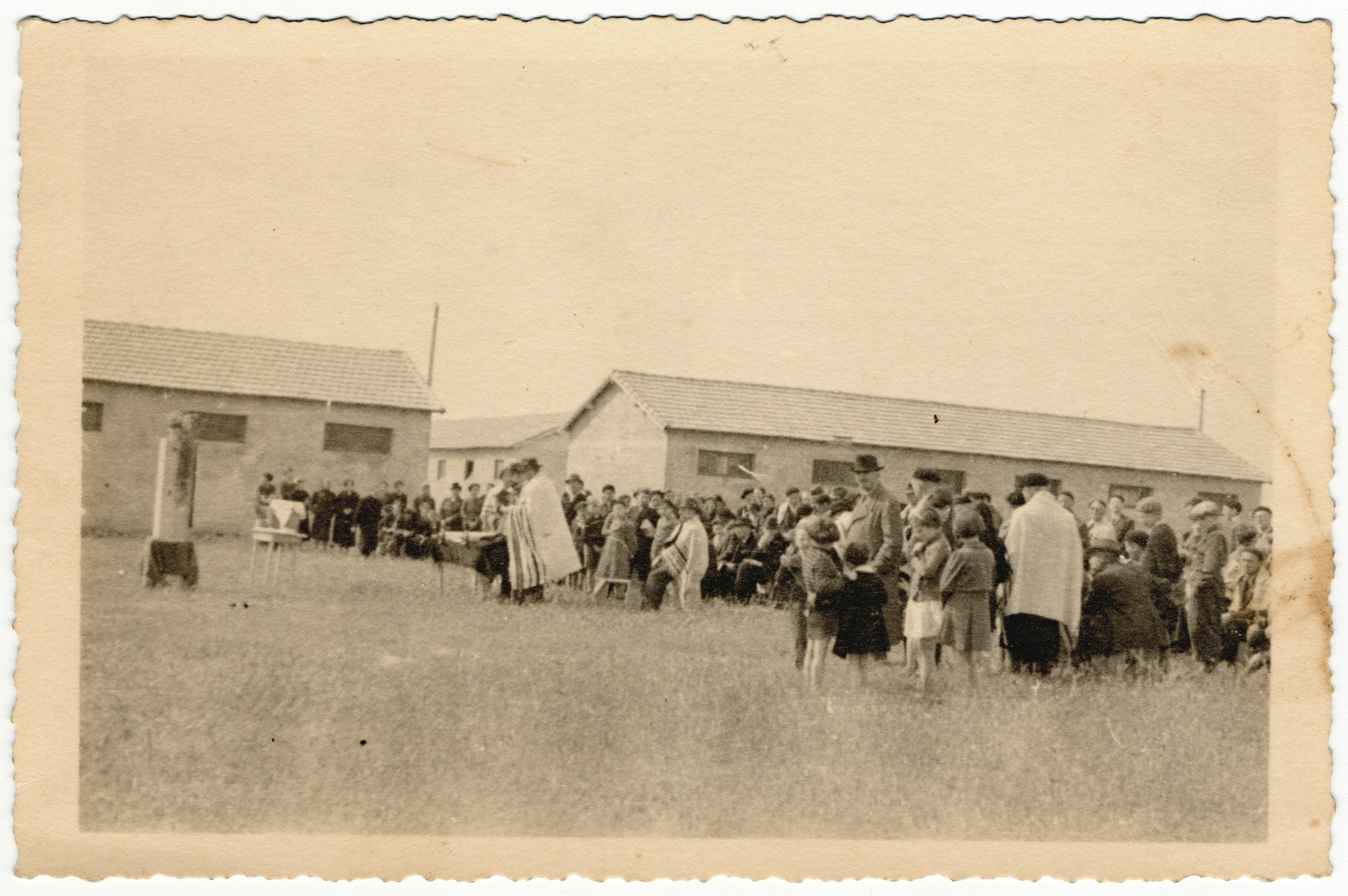 Jewish prisoners at the Rivesaltes internment camp in southern France hold an outdoor prayer service.