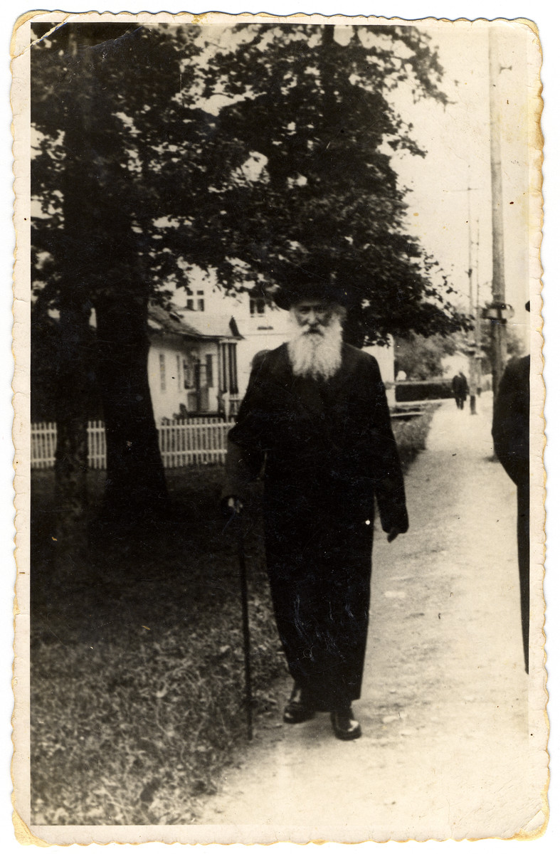 "Street portrait of the Rabbi of Krosno, Rabbi Schmuel Fuehrer.   The caption on the back of the photograph reads: ""received on July 9, 1939 in Truskawiec""."