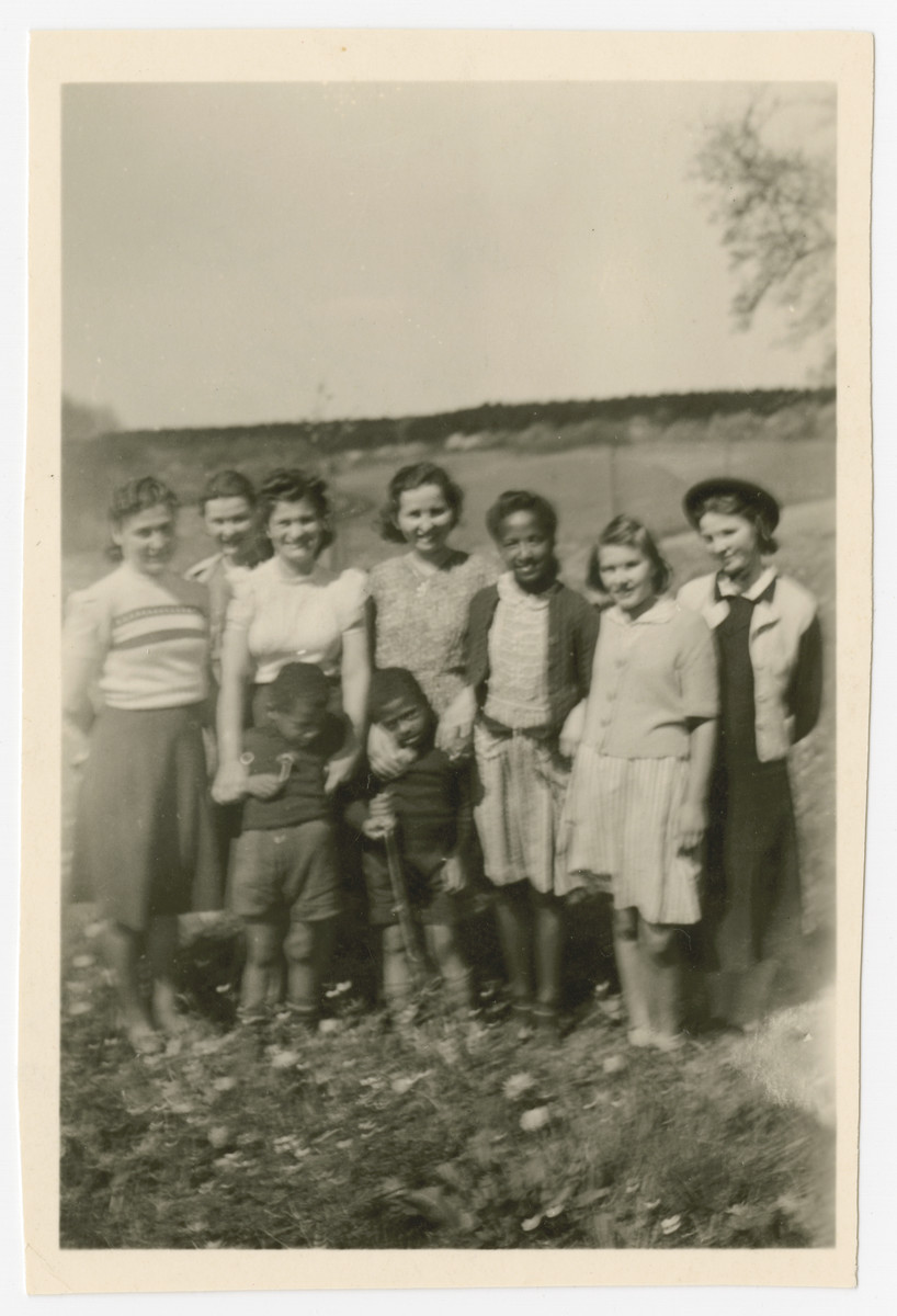 Group portrait of children and teenagers in the Liebenau internment camp.