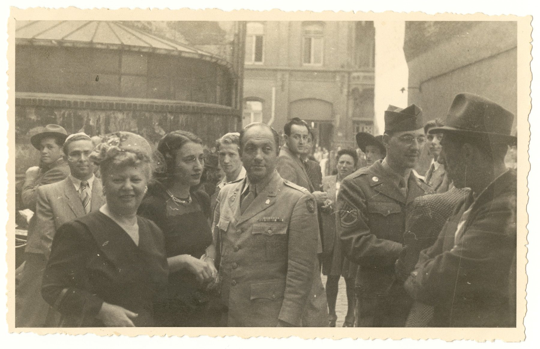 Jewish displaced persons and aid workers gather after Rosh Hashana services, probably in Wiesbaden.