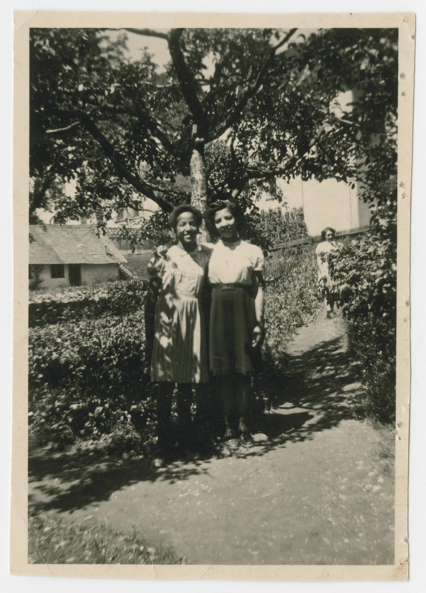 Marilyn and Jacky Johnson stand on the grounds of the Liebenau internment camp.