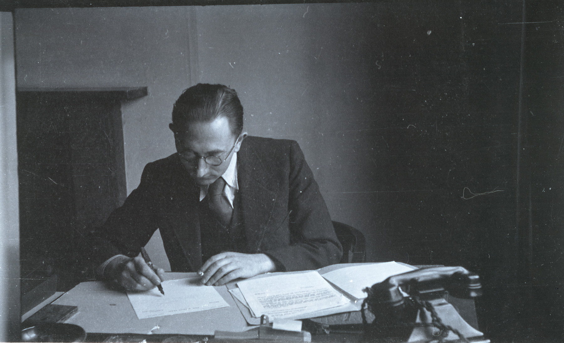 A member of the Revisionist Zionist organization in London works at his desk.