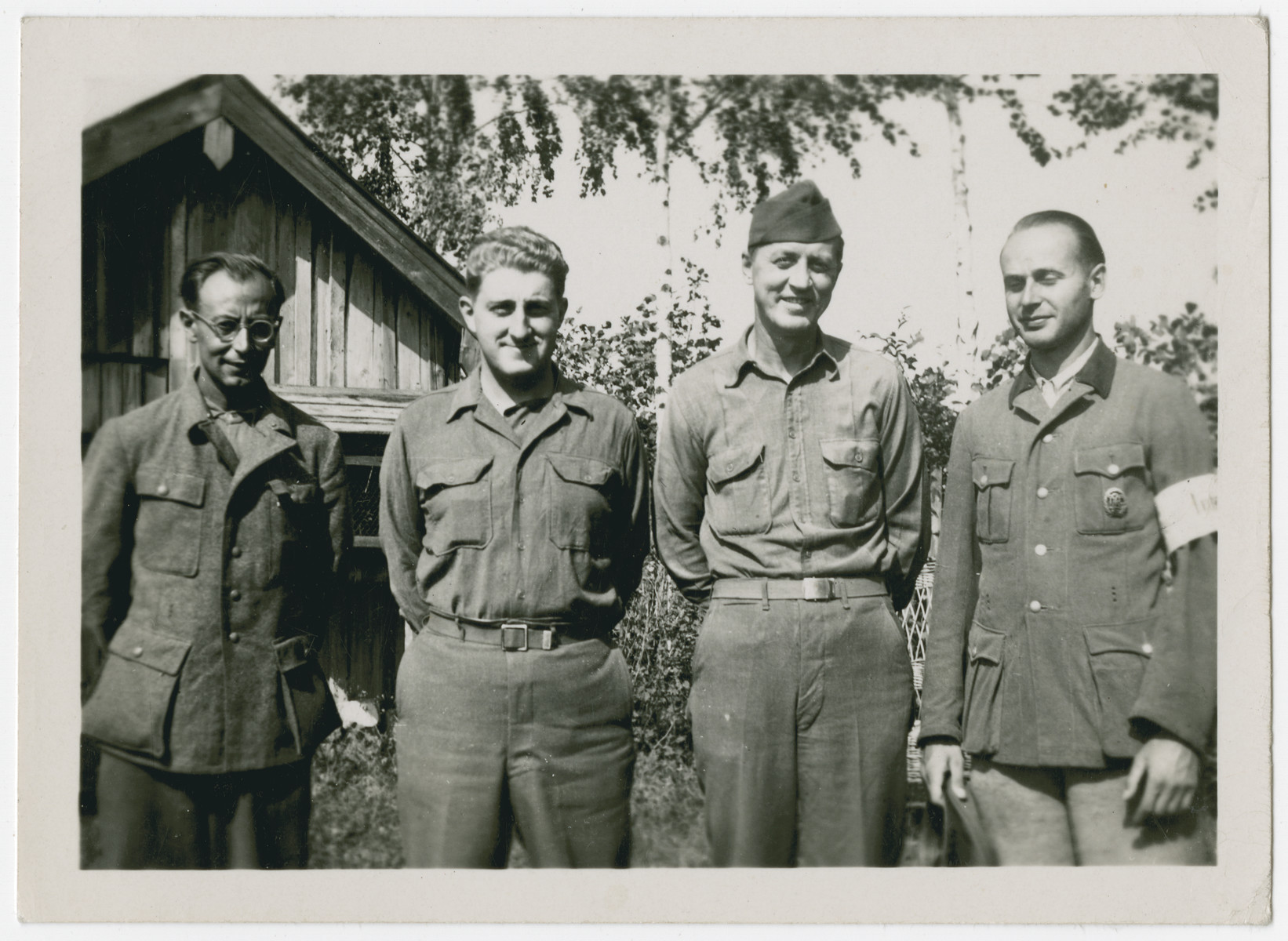 Two American soldiers pose with former members of the Wehrmacht  Norman Coulson is second from the left standing next to the other American soldier.