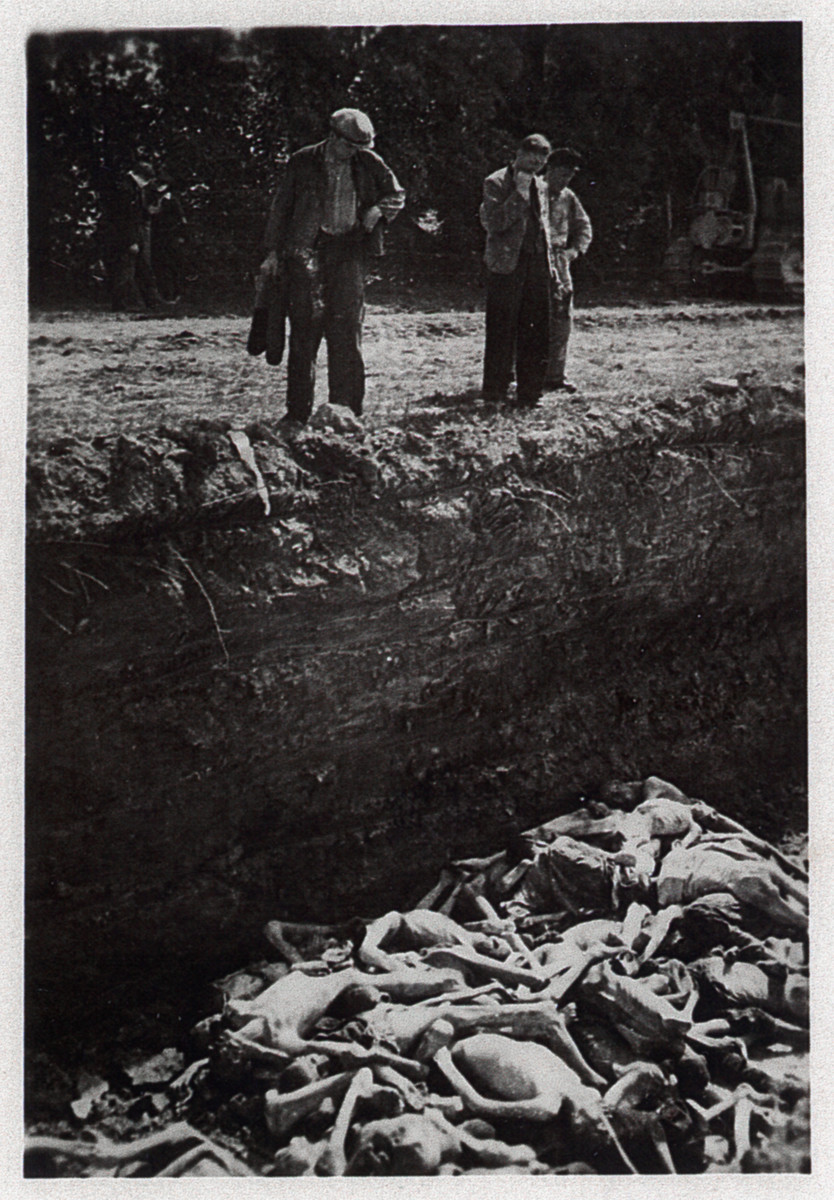 Members of the 843rd Aviation Engineers of the US Army find a pit of victims shortly after the liberation of Dachau Concentration Camp.