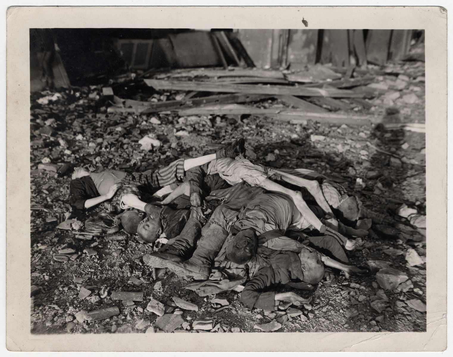A pile of corpses is mounted on top of the rubble in the Nordhausen concentration camp.