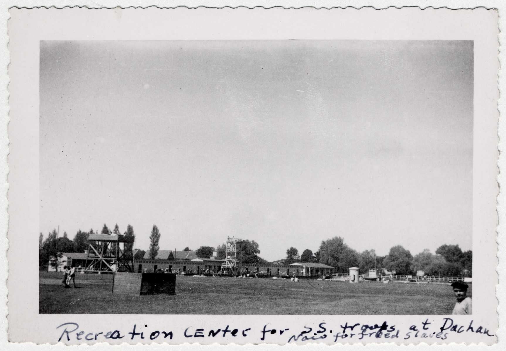 "View of the SS recreation fields in Dachau following liberation.  The original caption reads ""Recreation center for SS troops at Dachau now for freed slaves""."