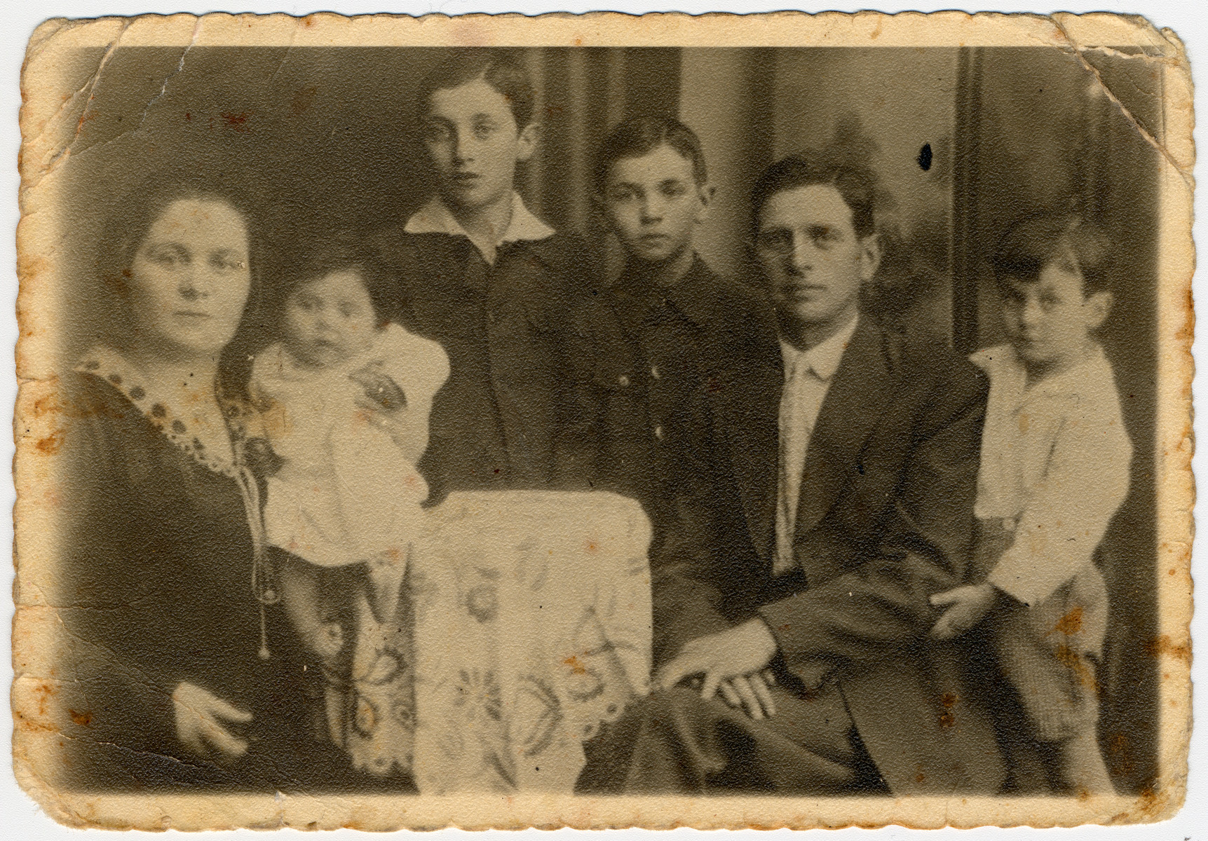 Prewar photograph of the Klinger family.  Pictured are Rozja-Laja, Bala, Josef, Dawid, Joel and Szlamek Klinger.  On the reverse side of the photograph is an inscription from Dawid and Szlamek sayng they are sending this card as a memory of their family.