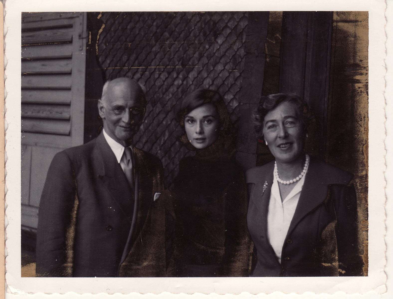 Otto and Fritzi Frank pose near her home in Lucerne, Switzerland with the actress Audrey Hepburn where they were trying to convince her to play the role of Anne Frank in the movie directed by George Stevens.