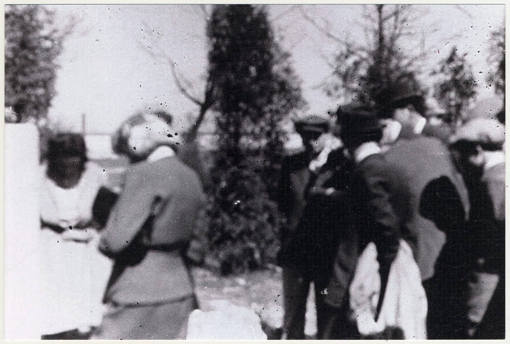 Mourners march to the gravesite during the funeral of Joel Klinger.  The lady whose back is towards the camera is Ruth Klinger , soon to be Piotrkowski.